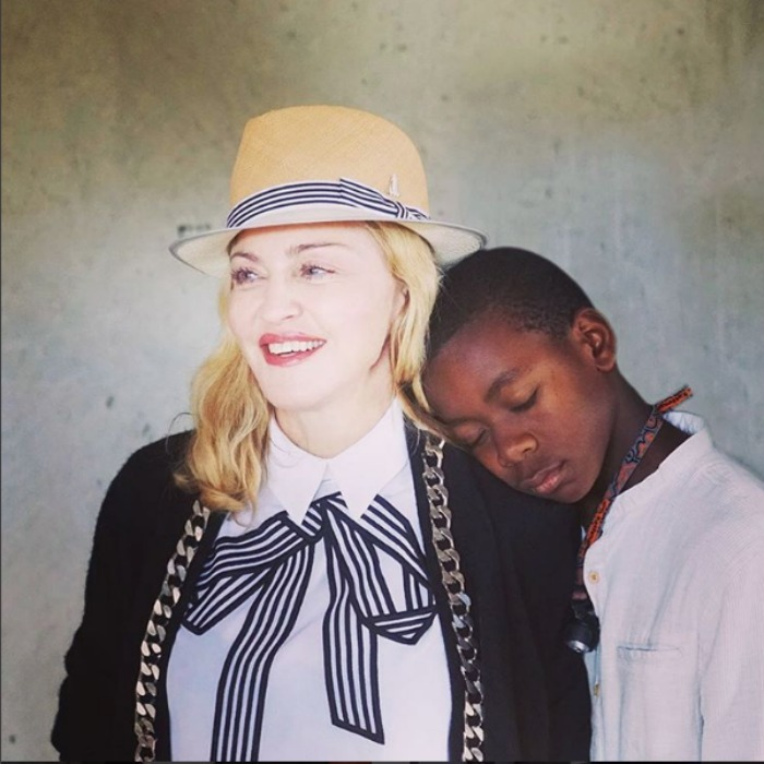 "Madonna captioned this image with her son David, ""Love is All we Need.""