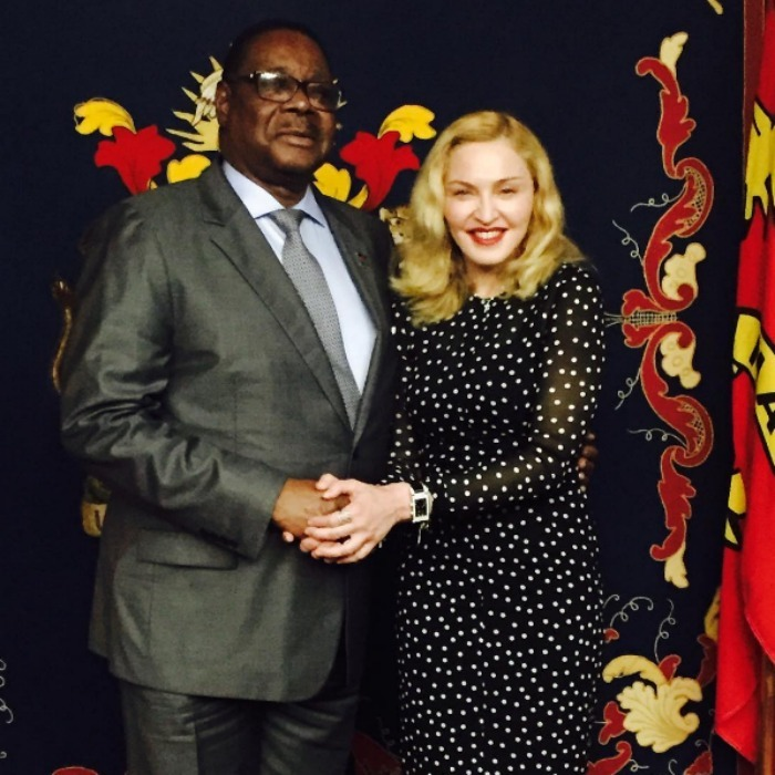 "Madonna posed for a portrait with President Peter Mutharika after discussing ""food security, education for girls and staffing for our new Pediatric hospital in Blantyre with Nurses And Clinical Officers.""