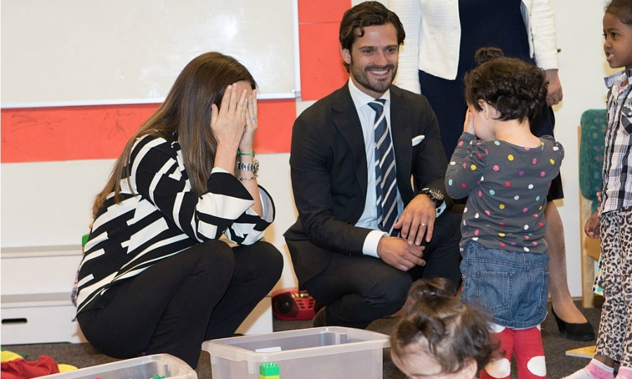 "Peek-a-Boo! <a href=""http://us.hellomagazine.com/tags/1/princess-sofia/""><strong>Princess Sofia</strong></a> of Sweden played with a new friend, while visiting a consultant unit for refugees during her and Prince Carl's trip to Dalarna.