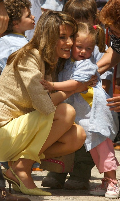 "Respect the perimeter! One little girl wasn't too pleased about being hugged by Queen (then-Princess) <a href=""http://us.hellomagazine.com/tags/1/queen-letizia/""><strong>Letizia</strong></a> at the Claustro de Santo Domingo in the Baleares Islands.