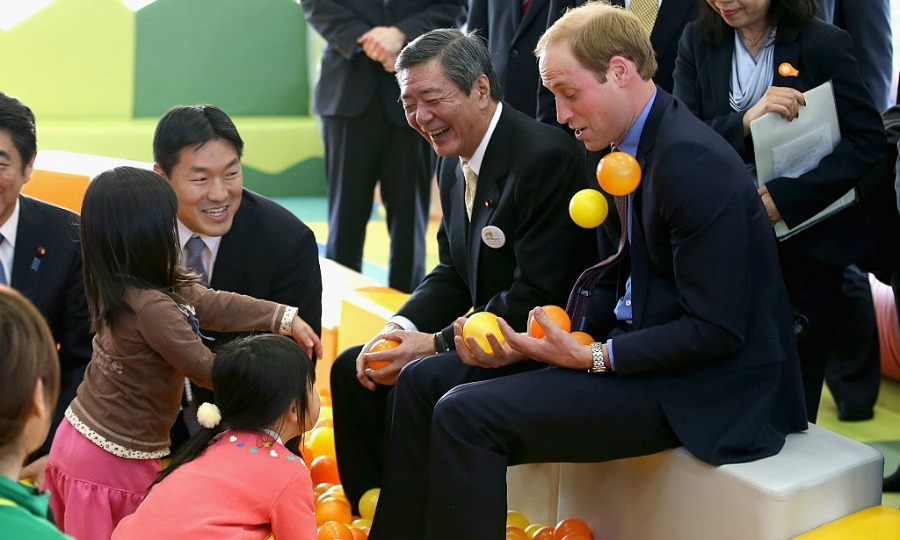 "A group of children had a ball — literally — with <a href=""http://us.hellomagazine.com/tags/1/prince-william/""><strong>Prince William</strong></a>. Young girls tossed balls at the Duke during his visit to Smile Kid's Park in Koriyama, Japan.