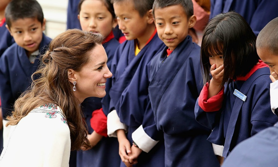 A young girl found herself with a case of the giggles meeting Princess Charlotte's mom during the royal's tour of Bhutan.