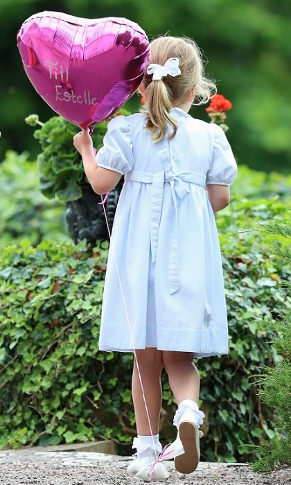 July 2016: Estelle held tightly onto her pink heart-shaped balloon, which featured her name, while walking around the grounds of Solliden Palace.