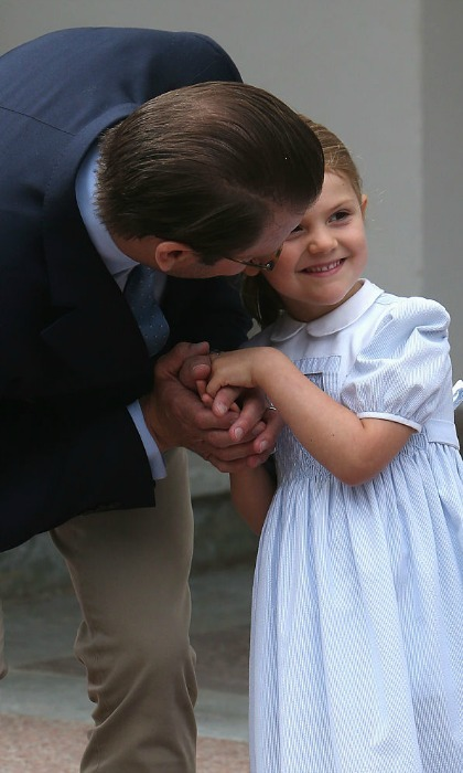 July 2016: Daddy's little girl! Estelle clasped hands with her father Prince Daniel as they celebrated their mom/wife's 39th birthday.