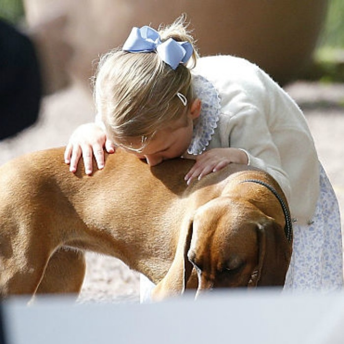July 2015: Man and Estelle's best friend. The Swedish Princess sweetly planted a kiss on a dog at her mom's 38th birthday celebrations.
