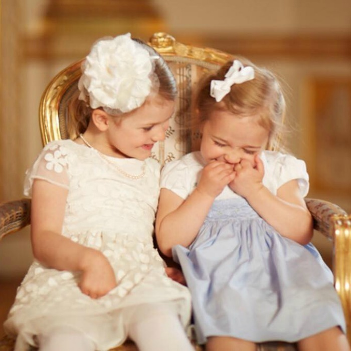 May 2016: Princess Madeleine of Sweden posted a precious photo of her daughter Princess Leonore sharing a laugh with her older cousin Estelle at Prince Oscar's christening.