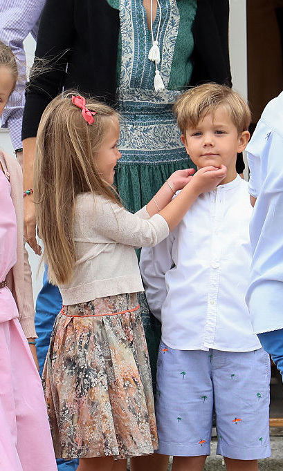 Josephine tried to put a smile on her brother's face during the photo shoot.  