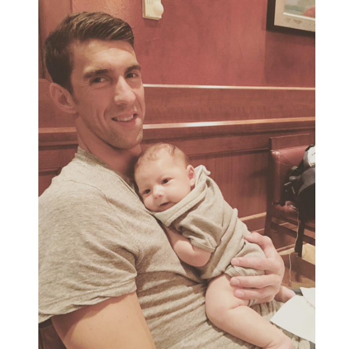 Michael Phelps' little boy was a happy camper in his dad's arms.