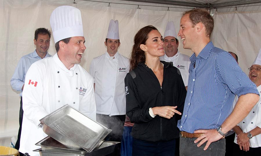 Kate gently put her arm around her husband as they tried different local delicacies in Charlottetown, Prince Edward Island. 