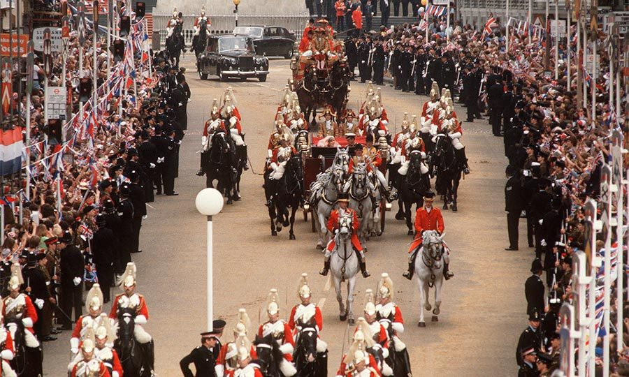 Diana and Charles were escorted to the palace by the Household Cavalry as they waved to the immense crowd of well-wishers. 