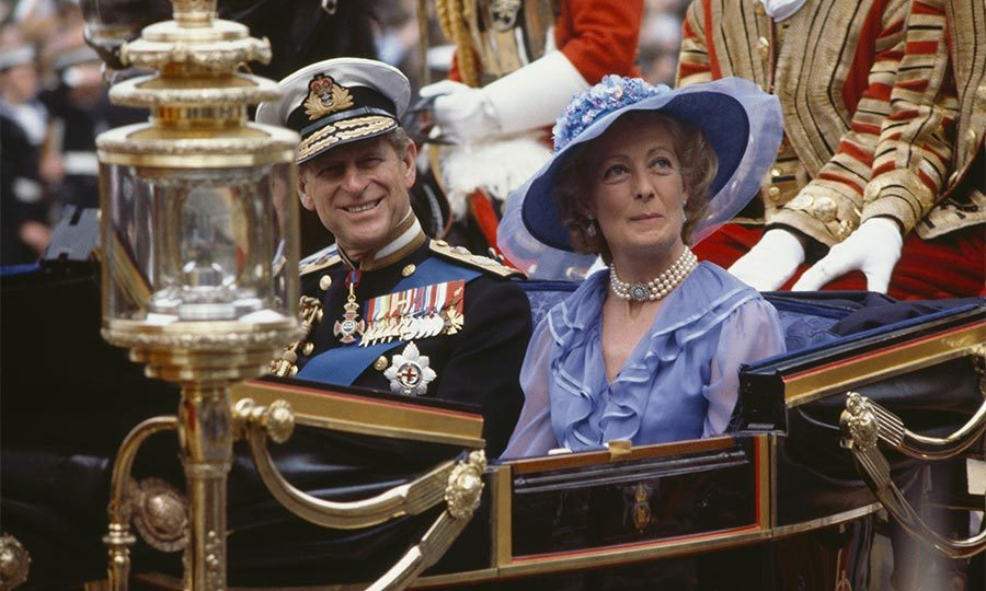 The father of the groom, Prince Philip, Duke of Edinburgh, and the mother of the bride, Frances Shand Kydd, rode together in an open carriage on their children's wedding day.