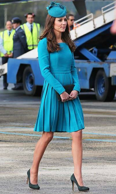 The Duchess wore an aquamarine Emilia Wickstead dress as she touched down in 2014 at New Zealand's Dunedin International Airport.