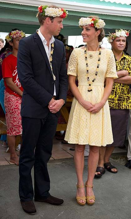 An independent dressmaker created Kate's lemon broderie anglaise dress, which she paired with Stuart Weitzman wedges. The Duchess added another accessory with a flower crown, which was made for her by the children of a primary school in Tuvalu.