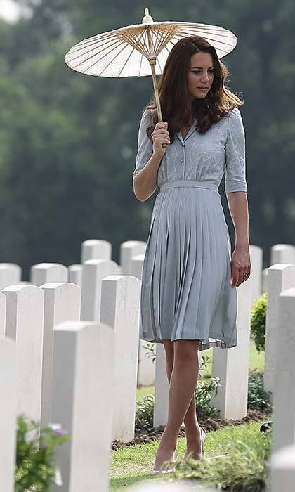 Kate stuck with her favorite designers for a trip to the Kranji war memorial, opting for a Jenny Packham dress and L.K. Bennett heels. She added a nude parasol to protect her from the heat in Singapore.