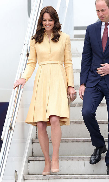 Kate turned to one of her favorite designers for her arrival in Bhutan. With temperatures considerably cooler in the mountain kingdom than in India, the stylish royal stepped off the plane in a soft yellow gold coat dress by Emilia Wickstead – a go-to piece from her enviable wardrobe.