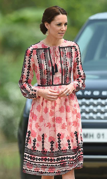 Showing us that it isn't all about designer tags, Kate modeled a stunning pink Topshop dress with intricate black embroidering. Princess Charlotte's mom added a touch of sparkle to the look with her bargain $11 earrings from Accessorize.