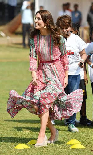 Kate later slipped into a mid-length pink and green chiffon dress by Mumbai designer Anita Dongre.