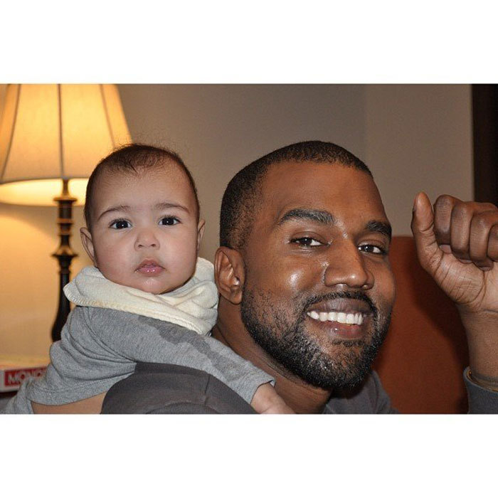 "Proud dad <a href=""http://us.hellomagazine.com/tags/1/kanye-west/""><strong>Kanye West</strong></a> beamed as his daughter North West adorably held on to his back. 