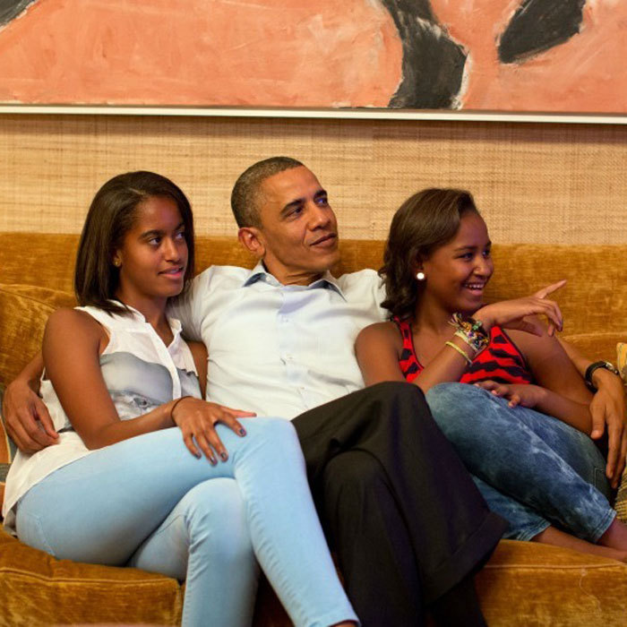 "President <a href=""http://us.hellomagazine.com/tags/1/barack-obama/""><strong>Barack Obama</strong></a> cozied up between his daughters Malia and Sasha to watch Michelle Obama deliver a speech at the 2012 Democratic National Convention. 