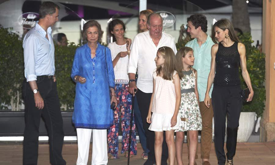 Family night out! King Felipe and Queen Letizia were joined by their extended family for an evening out in Mallorca. The Spanish royals are on the island enjoying their annual summer vacation.