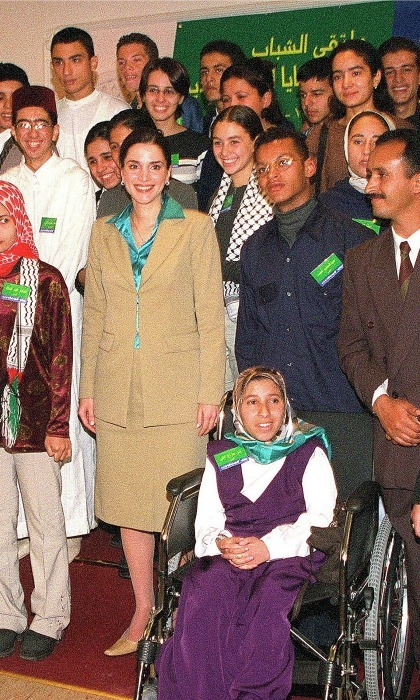 November 2000: The royal stayed conservative in a beige skirt suit during a meeting for young people in Amman. 