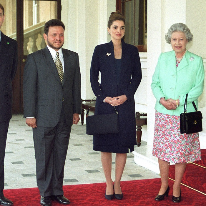 May 1999: Dressed to impress! Rania went for an understated dark navy suit as she and her husband met with Queen Elizabeth at Buckingham Palace. 