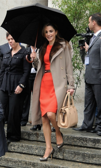 October 2009: An orange dress and oversized purse while leaving Palazzo Mezzanotte in Milan. 