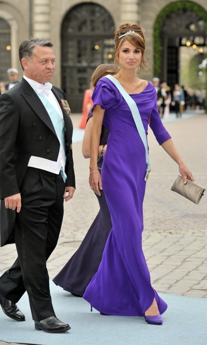 June 2010: Pretty in purple! The stylish Queen wore a bright floor length gown for the wedding of Crown Princess Victoria and Prince Daniel in Sweden. 