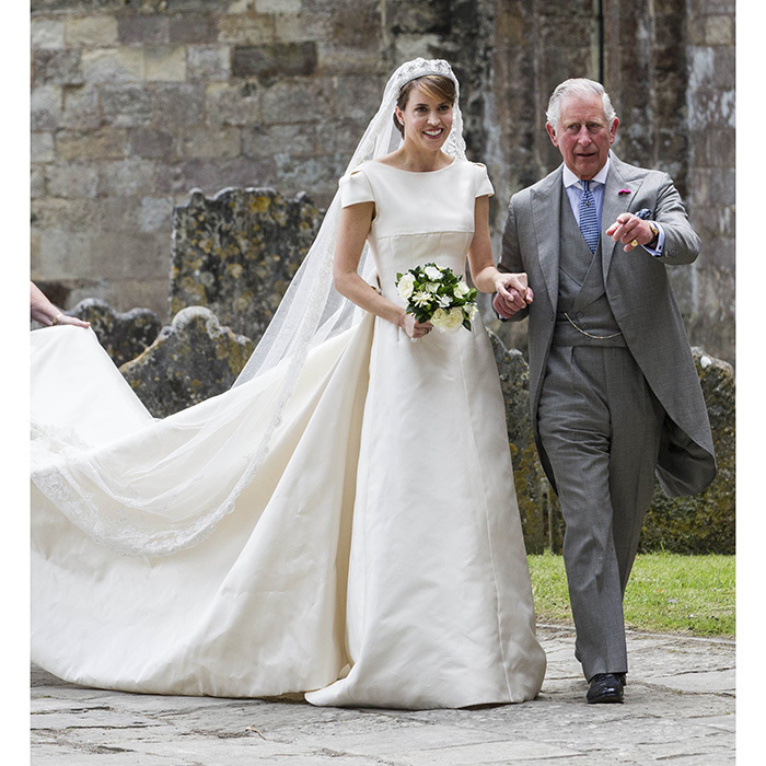 Alexandra, who is the daughter of Prince Charles' close friend, Lord Brabourne, was walked down the aisle by the heir to the British throne. 