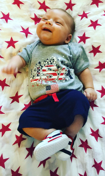 "Before flying to Rio to meet his father, adorable baby Boomer rallied Team USA fans with a post that read: ""I'm ready for this summer!! Are you?!?""
