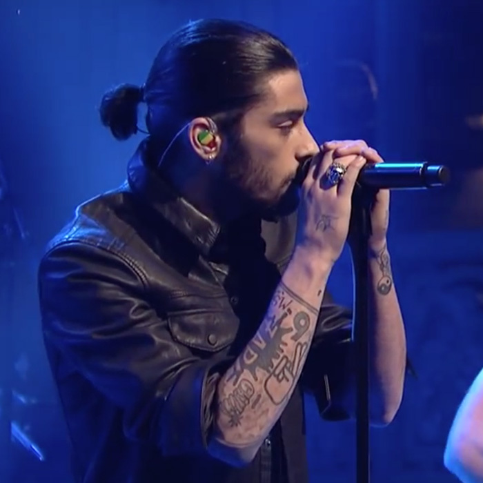 "<a href=""http://us.hellomagazine.com/tags/1/zayn-malik/""><strong>Zayn Malik</strong></a> swept up his black locks into a tiny ponytail for a 2014 performance on <i>Saturday Night Live</i> with One Direction.
