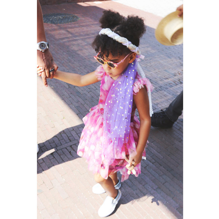 Blue Ivy is proving to be a fashionista in the making. Beyonce posted a photo of her little girl rocking a whimsical pink frock and pigtails in New York City. Blue accessorized her stylish look with a pair of matching shades.