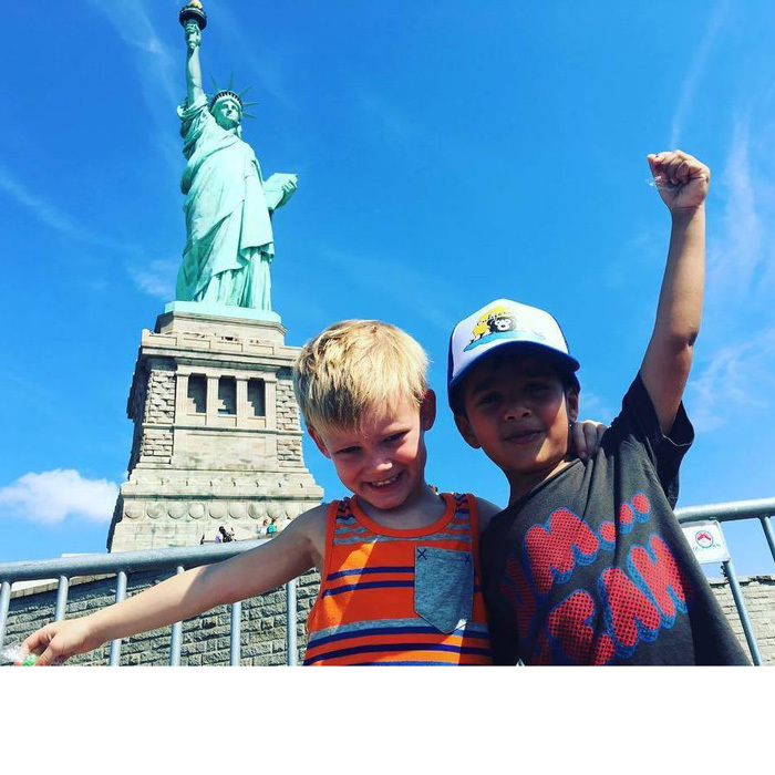 "Summer in the city! <a href=""http://us.hellomagazine.com/tags/1/hilary-duff/""><strong>Hilary Duff</strong></a>'s son Luca Comrie posed with a friend in front of the Statue of Liberty in New York.
