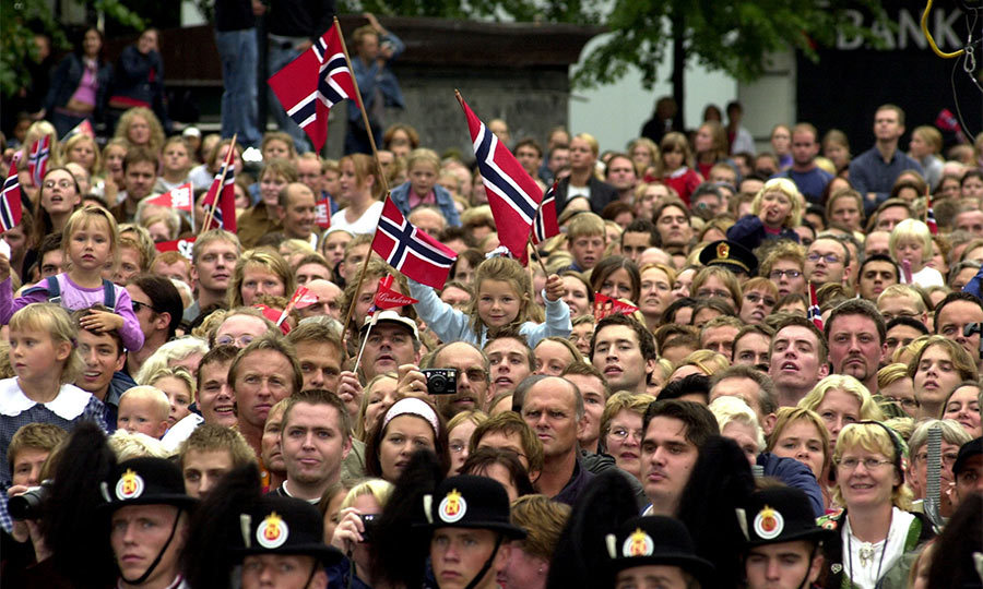 The streets had been wreathed in red, blue and white flowers, and hundreds of banners fluttered in the breeze. <br>Scores of Norwegian flags were carried by ordinary well-wishers who came in their thousands to cheer their future monarch and his wife-to-be.