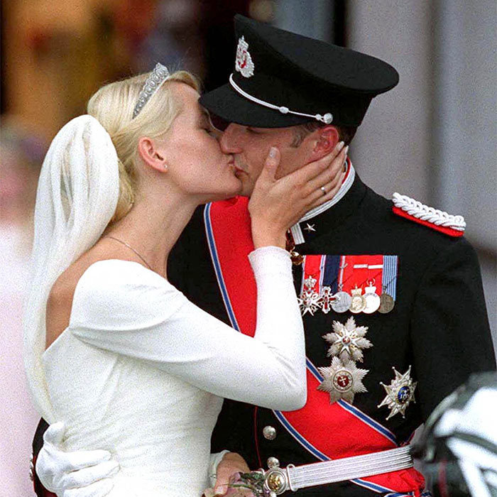 As Crown Prince Haakon and Crown Princess Mette-Marit emerged from the cathedral into the clear Oslo evening, the crowd roared its approval. The couple turned to each other and gave the onlookers something to remember: a first kiss as husband and wife. 