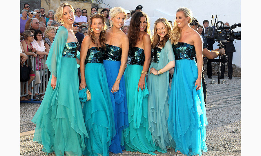 Tatiana's six beautiful bridesmaids, close friends of the bride, wore sequin-top strapless gowns in various turquoise hues of the Aegean.