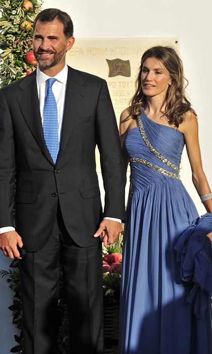 Nikolaos' Greek-born aunt Queen Sofia of Spain attended with her children, the Infantas Elena and Cristina, and Crown Prince Felipe. At Felipe's side was his style icon wife Crown Princess Letizia, who'd chosen an embellished Felipe Varela goddess gown for the ceremony. 