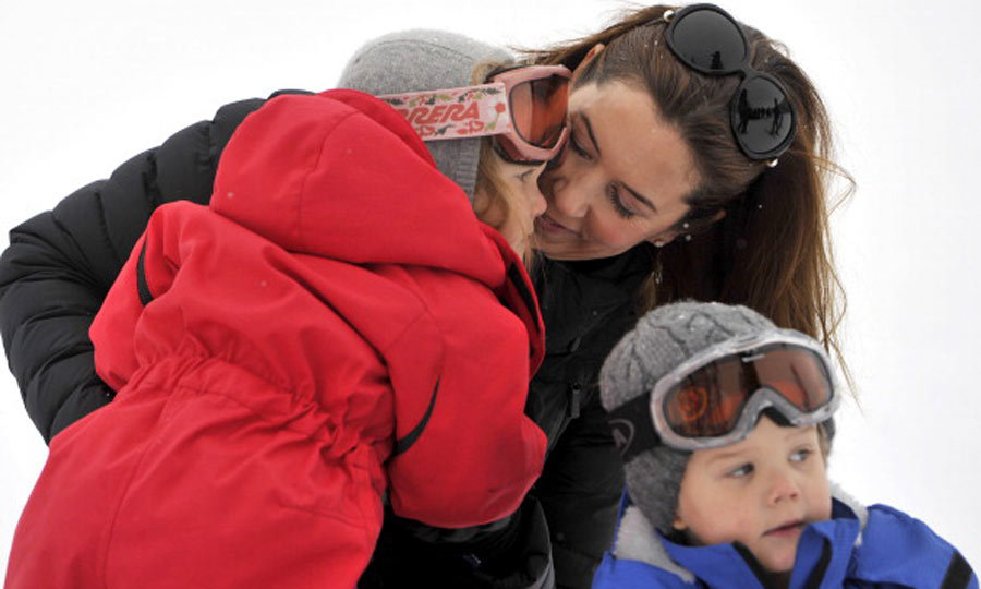 All bundled up! Princess Mary snuggled close to Josephine, while Vincent waited to have his photo taken during the family photo call in Verbier, Switzerland in February 2014. 
