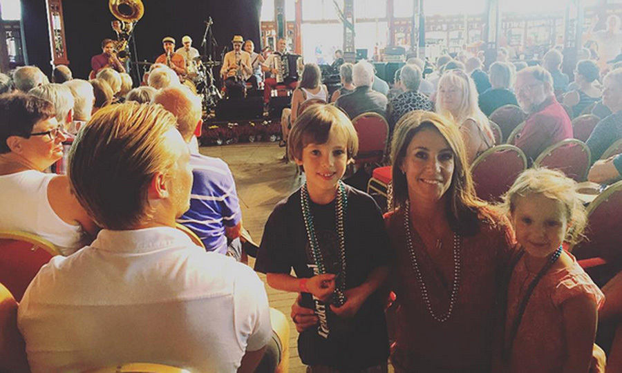 Princess Marie of Denmark enjoyed the performances at the Tonder Festival, featuring folk music, with her children Prince Henrik, seven, and Princess Athena, four.