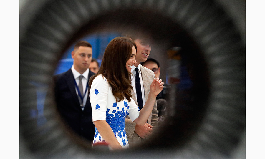 Tunnel vision: A new perspective on Kate Middleton as she chats with employees at the Centre of Excellence for Hayward Tyler in Luton.