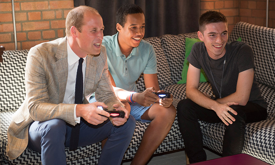 Prince William shows he's the King of gaming during a visit to Youthscape on August 24, 2016 in Luton, England. Prince William and his wife the Duchess visited Youthscape at Bute Mills to tour the facility and learn about the charity's important work with young people. 