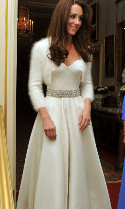 Burton again captures the simplicity and elegance of Kate with this minimalist gown for the reception following the wedding. 