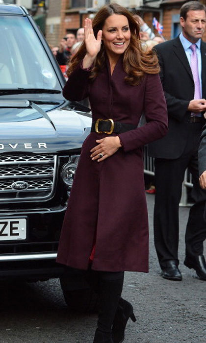 It seems Kate has taken a liking to Alexander McQueen coats! Here's another picture of the Duchess wearing a coat, this time in deep purple.
