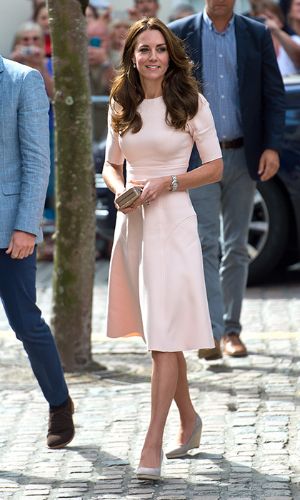 Kate Middleton was pretty in pink wearing a dress by American designer Lela Rose to her first engagement of the trip.