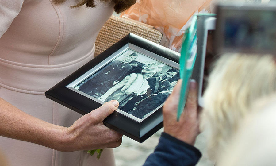 The Duchess was gifted a framed photograph by a spectator during her visit to Cornwall.