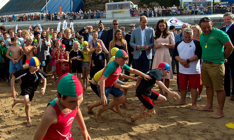Surf's up! The royals watched a demonstration by a surf lifesaving club in Towan Beach during their visit to Newquay, United Kingdom. 