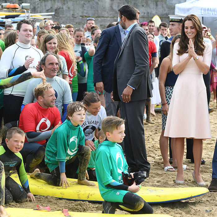 Kate seemed eager to chat with children on the beach during her visit to Newquay.
