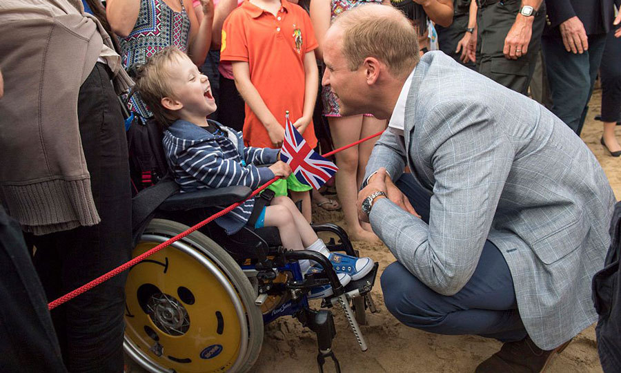 Prince William made Jaydon Mitchell-Tomlinson, who suffers from cerebral palsy, laugh while visiting the Wave Project in Newquay.