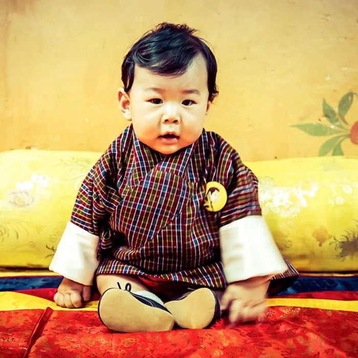 The little Prince looked adorable wearing a traditional Bhutanese robe and little shoes.