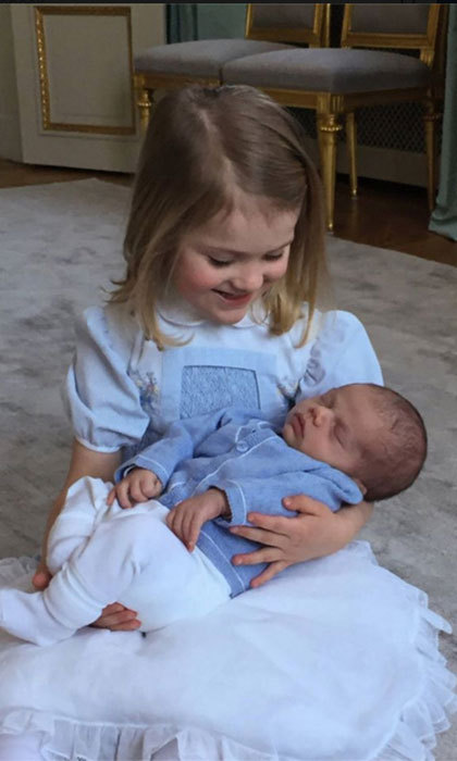 March 2016: Princess Estelle gently held her baby brother Prince Oscar in a new photo.